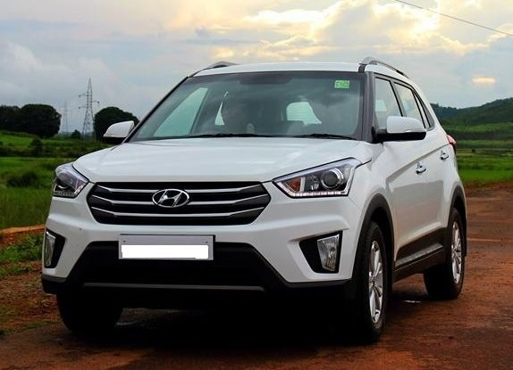 Hyundai Creta Pictures Gallery. Best Colour in Polar White, Passion Red, Sleek Silver, Phantom Black, Mystic Blue, StarDust Grey, Earth Brown Color